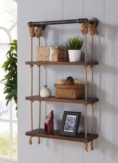 Hang-up the beautiful Modern Walnut Wood Floating Wall Shelf made from walnut wood, and silver finish pipes with reclaimed hanging rope shelves. Offers an industrial design with open shelves and slim cross bars on its sides and back. This functional, open design holds books or any ornaments in place while keeping them easily accessible. This metal bookcase is perfect for your home office, personal library or bathroom shelving.