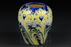 A Moorcroft MacIntyre Florian ware peacock pattern vase, tubelined decoration in tones of yellow...