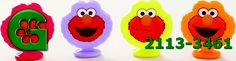 Wilton item number 2113-3461. Visit www.GalesWholesale.com for more information. 8pc Elmo Dessert Toppers - 1.5h. Elmo always adds fun to your celebration. Top your party cupcakes, treats, brownies, and more with Elmo�s bright smile! 1.5 in. high. Pk./8