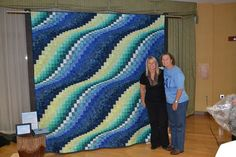 "from: Laura Hieronimus Bishop: ""I made this Bargello, ""Surf Song,"" for an auction in support of clean water in Uganda. Our local Rotary Club sponsored an event, ""Wine into Water"" last night. This was my first ""charity quilt"" and it was very special to me. My friend, on the left, lost her 17 year old son in an accident while coming home from a family vacation in 2009. Jesse wanted to be an engineer and provide clean water to people in third world countries. His family started a charity in his…"