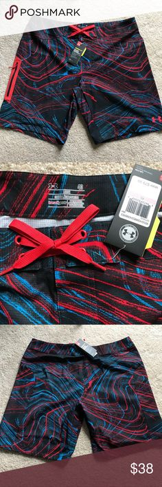 "Under Armour Board Shorts Men's 40W Under Armour  VENT Board Shorts Loosefit Style with Heatgear fabric and Storm1 water repellent keeps you dry inside when its wet around you.  11"" inseam Black with Blue and Red design Zipper side pocket Under Armour Shorts Athletic"