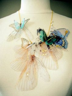 Spectacular butterfly jewelry.  Love this artist's work.