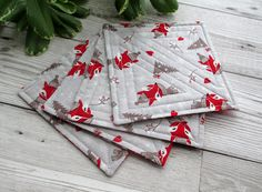 A set of 4 quilted coasters in a fun festive fox print fabric, a great way to add some Christmas cheer to your home this festive season! I have made these coasters using 2 fabrics, a fox print fabric for the front & a red snowflake fabric for the b. Quilted Coasters, Fabric Coasters, Christmas Decorations, Holiday Decor, Christmas Gifts, Handmade Decorations, Christmas Trees, Holiday Gifts, Xmas