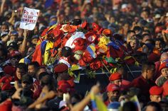 March 6, 2013. Supporters accompany the funeral cortege of late Venezuelan President Hugo Chavez on its way to the Military Academy.