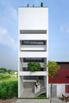 """Completed in 2016 in Từ Sơn, Vietnam. Images by Trieu Chien. """"A House in Trees"""" locates in a small narrow land, which was divided with the area of 5x15(m) in Tu Son town, Bac Ninh, Vietnam. This area is facing..."""