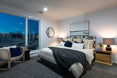 Darker toned carpets add a layer of warmth and cosiness to any bedroom!