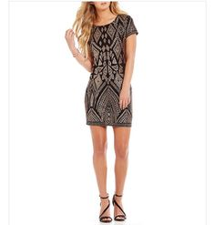 everything I want in a dress. short, black, and detailing