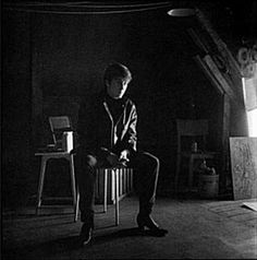John Lennon sitting in Stuart's attic studio, shortly after receiving news of Stuart's death. Photo by Astrid, Hamburg, Germany.
