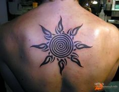 Upper Back Spiral Sun Tattoo For Men photo - 1