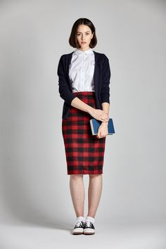 - Below-the-knee plaid pencil skirt - High-waisted - Lined with pink satin finish - 50% Wool, 50% Polyester *Model is 6ft & wearing a US size 2