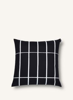 Marimekko's Tiiliskivi cushion cover features a simple grid pattern designed by Armi Ratia in Timeless Tiiliskivi is perfect for minimalist interiors, and it also creates an intriguing contrast with rich and colourful patterns.