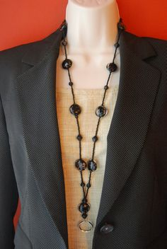 Beaded Lanyard Black and Copper/Bronze Glass Bead Lanyard ID Badge Glasses Holder. $20.00, via Etsy.