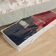 Stow sweaters and quilts in this cotton canvas under-bed storage box, showcasing a convenient clear top panel and zippered closure.      ...
