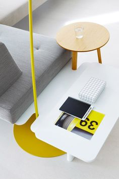 lamps and side tables can be docked by slotted panels,  becoming an integral part of the furniture islands -the modular furniture system 'docks' by berlin-based designers till grosch and björn meier can be combined in various ways to create different office islands.   image © milligram architectural studio
