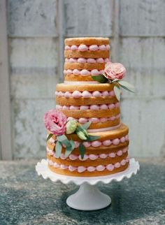 This naked cake is very interesting. I like how the icing looks like pearls.