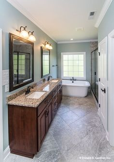 A soothing master bathroom for relaxation! The Whitford #1298-D. http://www.dongardner.com/house-plan/1298-D/the-whitford. #MasterBathroom #Bathroom #DreamHome