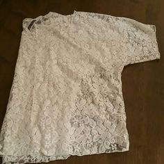 Lace short sleeved shirt from Buckle In great condition! Comes right to the top of your pants. BKE Skirts A-Line or Full