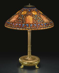 """** Tiffany Studios New York """"Russian"""" leaded glass and patinated bronze table lamp."""