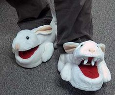 Keep your feet warm with these comfy Monty Python inspired killer rabbit slippers. As you walk, the deadly sharp rabbit's mouth opens and closes on the slipper, giving off a fun effect that will strike terror in the eyes of anyone in your path.