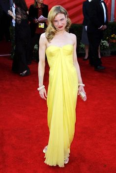 RENEE ZELLWEGER  Renee Zellweger's timeless pastel yellow strapless Lily et Cie dress that she wore to the 2001 Oscars has quite rightly gone down in fashion history. It is simple yet vibrant, elegant yet contemporary, there is absolutely no room for improvement. (2001)