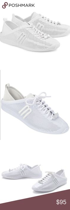 Melissa Love System Tennis Shoes Size 7 Run errands, go out with friends, or enjoy a day in the sun with these versatile Melissa sneakers. Designed with chic perforated PVC, theses lace-up tennis shoes feature a neoprene tongue and heel cap. Material: PVC. Footbed: Slightly Padded. Toe shape: Round. Shoe width: Medium. Color: White. Size: 7. Melissa Shoes Sneakers