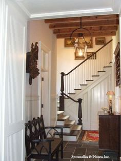 Staircase with a crook, exposed beams, & grey, slate tile. English charm!