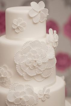 Rachelles Beautiful Bespoke Cakes.  Decorated with opaque rice paper flowers