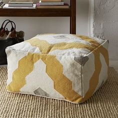 Bazaar Pouf. west elm. $249. Bring in an interesting graphic inspired by Moroccan trellis work with this multi-use pouf. Use for casual seating or as an ottoman.