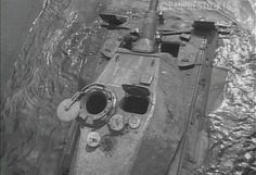 Ariel view of a German King Tiger II crossing a river.