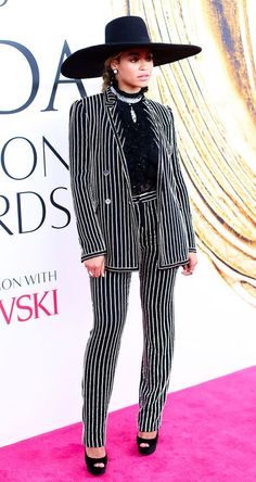 Honored with the CFDA's 2016 Fashion Icon Award, Beyoncé provided celebrity star power on the council's Red Carpet. Her striped Givenchy pantsuit had tongues wagging, but as Eonline.com pointed out: it was appropriate for the evening's special tribute to David Bowie. We love Queen Bey's two-tone earrings and on-trend collar necklace.