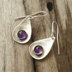 Hammered Teardrop Dangle Earrings Amethyst cabochons sterling silver. $48.00, via Etsy.