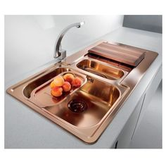 Kitchen sinks and taps don't have to be white and silver - copper sinks and taps can make a stunning feature.