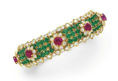 A DIAMOND, EMERALD AND RUBY BRACELET, BY DAVID WEBB