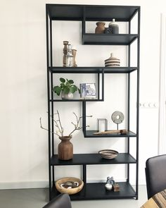 A 4 tier shelf unit, the style shelf with dark herringbone style wood and golden brackets is a free standing unit that you can move and re purpose around your living rooms, hallways, office and bedrooms for years to come.