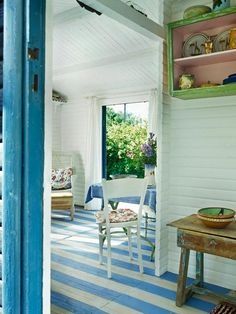 A blue and white paint job gives hardwood floors rustic character while concealing imperfections in the wood.  http://www.ivillage.com/blue-home-decor/7-a-533801