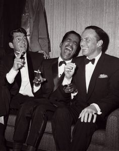 Dean Martin, Sammy Davis, Jr., and Frank Sinatra laughing and smiling (The Rat Pack)
