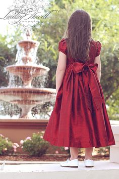 Elegance,   one word to describe this most beautiful red silk dress for little girls.