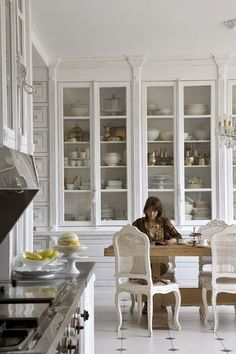 white kitchen tall floor to ceiling glass door cabinets. I Love this kitchen