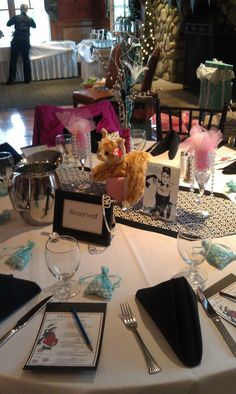 "A tiara for the ""mother to be"". Breakfast at Tiffany's Baby Shower. Table runners home sewn added a nice touch for centerpiece Eiffel Tower vases, Tiara & Pearls Cat."
