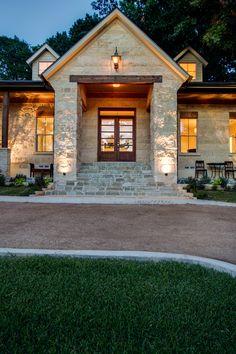 Oklahoma Flagstone clad stairs, gas lamp, shell and austin stone facade and cedar beams