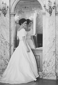 Such a beautiful wedding gown! High collar + sleeves + long skirt = an elegant, and truly lovely wedding dress. The kind of dress I want to have.