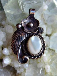 Charming Native American Silver and Mother of Pearl Pendant, 3-Dimensional Floral Motif with Curved Leaf, Bezel Set Stone, Unsigned, 1960-70 by postGingerbread on Etsy