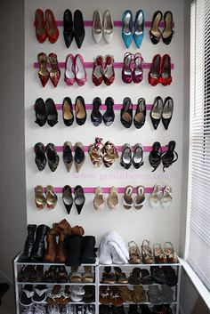 I did this is my closet using cheap crown moulding.  I was able to get 8 rows on the wall. I did have to put a strip of foam tape (i used the insulation foam you would use on a door frame) across the top of each piece of wood so that some of my skinnier heels wouldn't slip off.