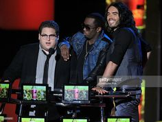 Jonah Hill, Sean 'P. Diddy' Combs and Russell Brand speak onstage at the 2010 MTV Movie Awards held at the Gibson Amphitheatre at Universal Studios on June 6, 2010 in Universal City, California.