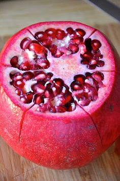How to peel a pomegranate; I LOVE! pomegranates!! This really works! The easiest time I've ever had getting those seeds out. Wow! Now we will have more of these tasty gems!!