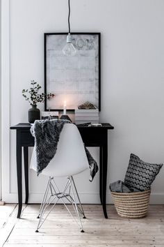 Staging for the small bedroom desk area - use little table from living room as desk, add modern chair, lamp. Neutral throw in the chair, Star Wars poster, and modern pendant light above.