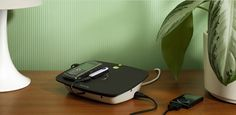 Conserve Valet™  Smart USB Charging Station    Charge up to 4 devices at once  Shuts off automatically and eliminates standby power  Keeps cords neat