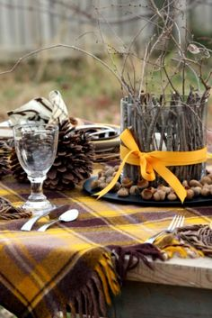 Sweet Something Designs: a pretty fall tablescape with a vintage wool blanket, pine cones, and branches.