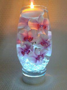 Pink Orchids With Purple Centers Float In A 10 Inch Glass Vase Filled With Water Perfect For Wedding Reception Centerpieces Or Home Decor - Haus Dekoration Floating Candle Centerpieces, Wedding Reception Centerpieces, Diy Candles, Floral Centerpieces, Floral Arrangements, Wedding Decorations, Hanging Candles, Wedding Arrangements, Creation Deco