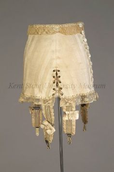 1926 Girdle. Pearl buttons, stretched garters, elastic corded front for adjustments.